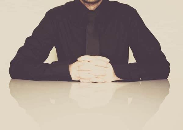 Régime social du dirigeant. Homme d'affaire au bureau.